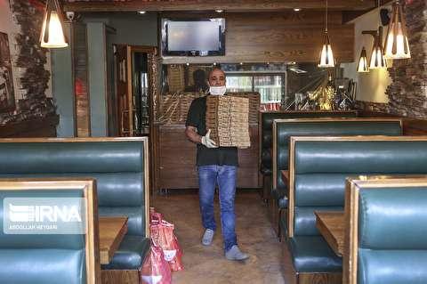 پخش پیتزای نذری در محله چهاردانگه